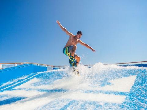 flowrider-surf-simulator-instructor-man-day-activity.jpg